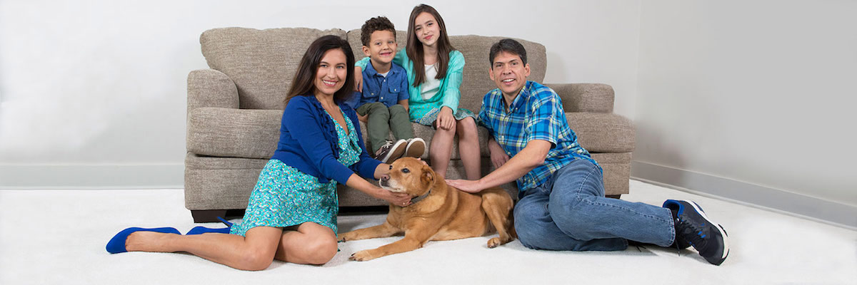 Family with Dog on Clean Carpet in Vancouver